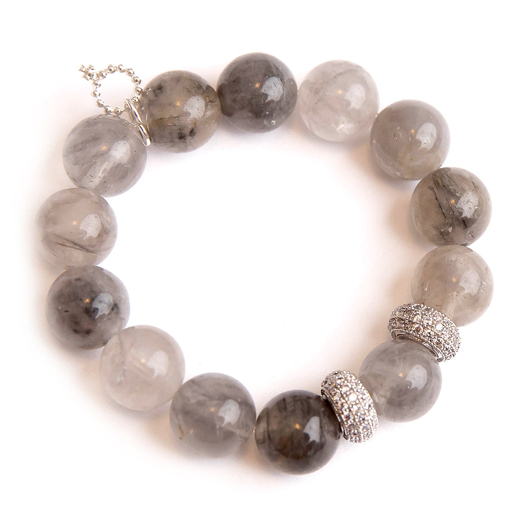 Light Grey quartz paired with silver rhondelles