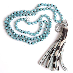 Faceted chambray agate hand tied gemstone necklace paired with a zebra striped leather tassel and silver ornate Blessed Mother medal