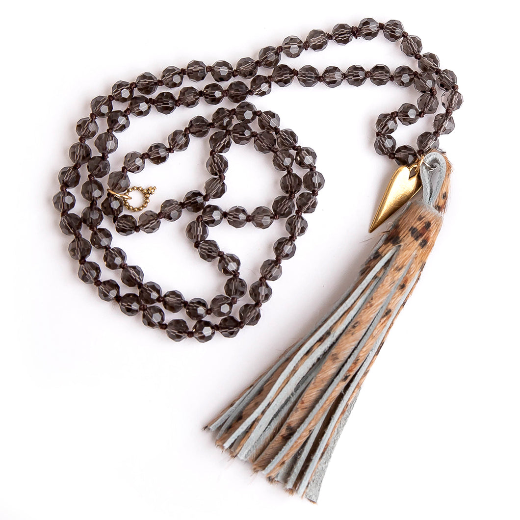 Faceted Smokey quartz hand tied gemstone necklace paired with a leopard leather tassel and a brass mended heart medal