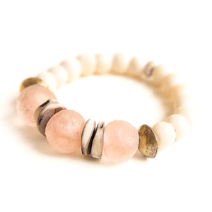 Blush sea glass paired with Ethiopian brass & heishi shell accents and hand carved bone beads