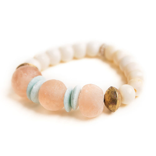 Blush sea glass paired with Ethiopian brass accents and hand carved bone beads