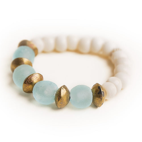 Aquamarine sea glass paired with Ethiopian brass accents and hand carved bone beads