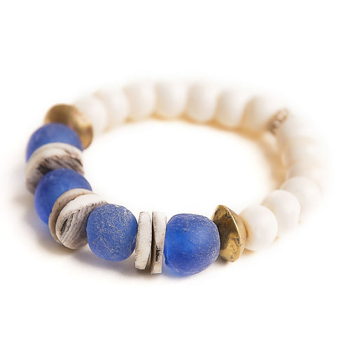 Cerulean blue sea glass paired with Ethiopian brass accents and hand carved bone beads