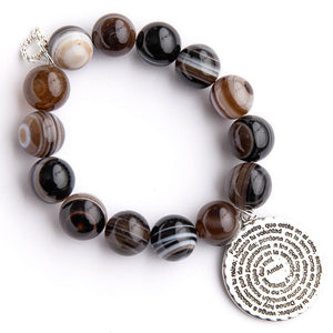 Brown swirl agate paired with the Lord's Prayer in Spanish