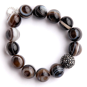 Brown striped agate paired with a gunmetal pave