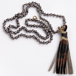 Hand tied grey quartz gemstone necklace with leather camo tassel featuring a brass queen bee
