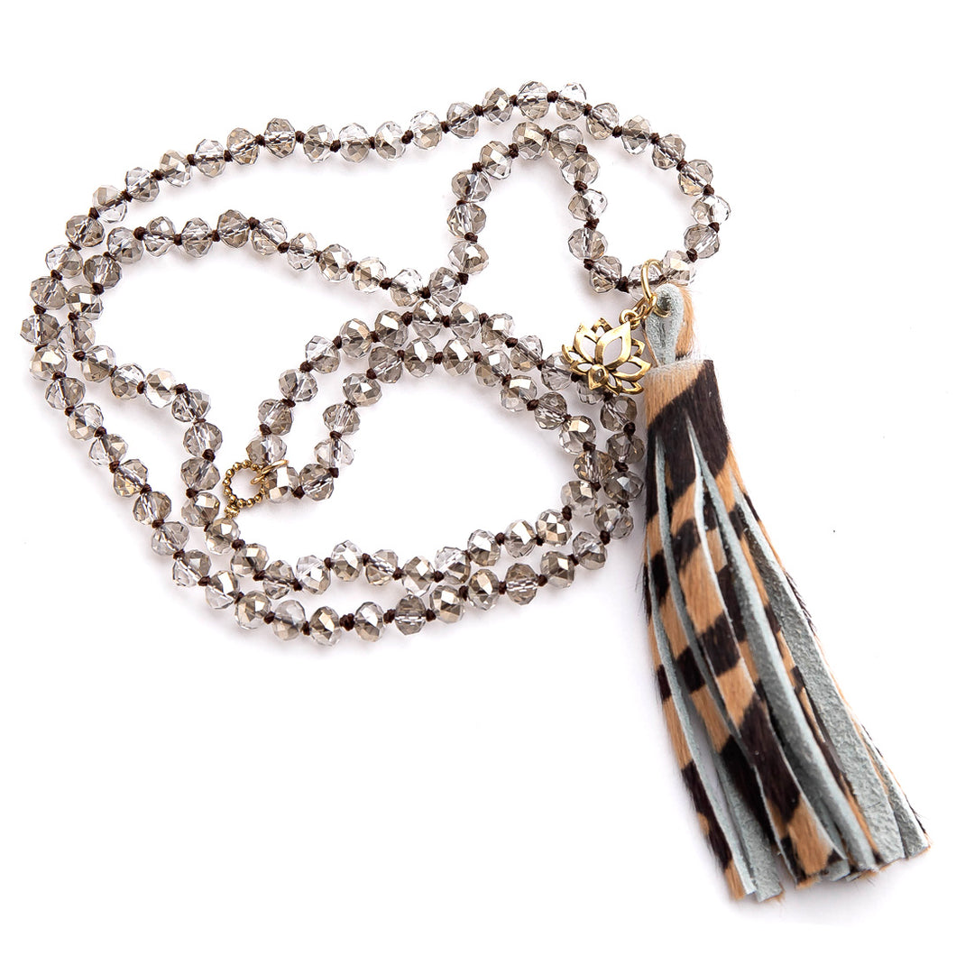 Hand tied Taupe crystal quartz gemstone necklace paired with a tiger print leather tassel featuring small brass lotus