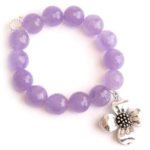 Faceted lilac agate paired with a dogwood flower medal