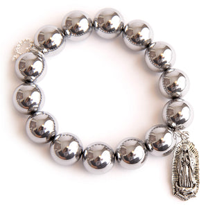 Silver hematite paired with an Our Lady of Guadeloupe medal