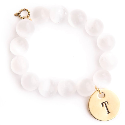 White calcite paired with a brass hand stamped initial medal