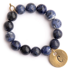 Dumortierite paired with a brass hand stamped initial medal
