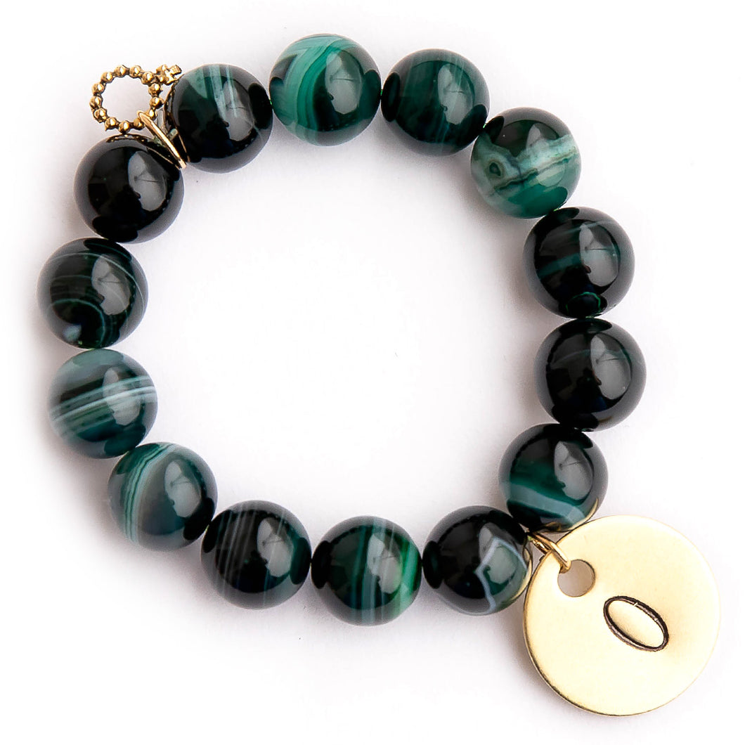 Emerald green striped agate paired with a brass initial medal