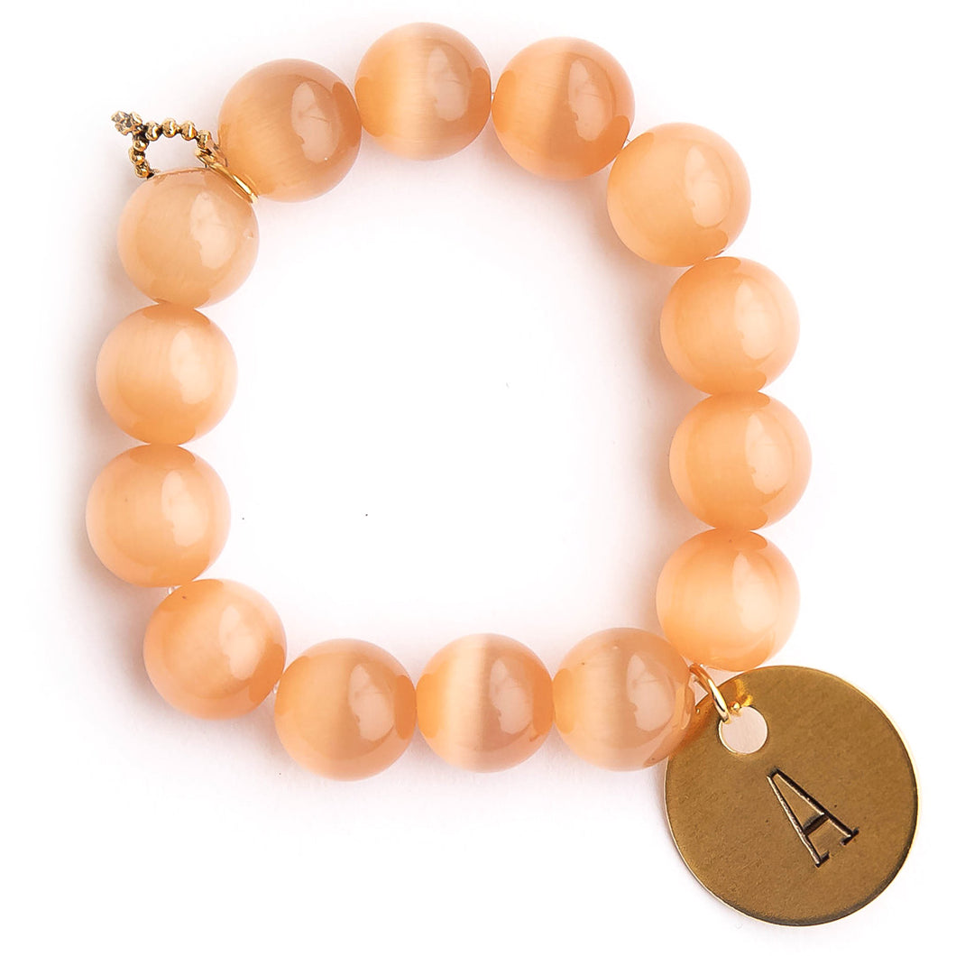 Cashmere calcite paired with a brass hand stamped initial disc
