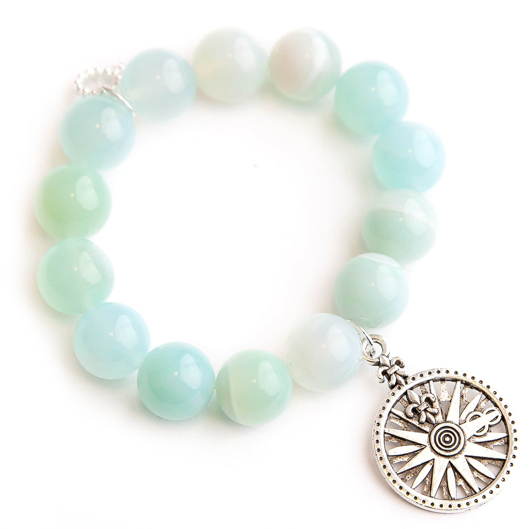 Caribbean agate paired with silver fleur di lis compass