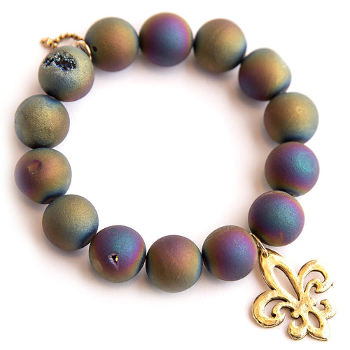 Matte iridescent druzy agate paired with a brass fleur di lis