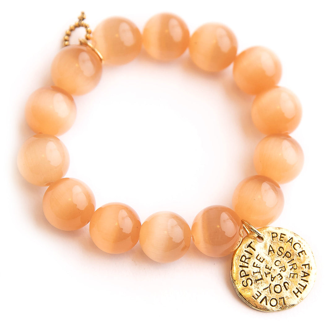 Cashmere calcite paired with bronze hammered spirit disc