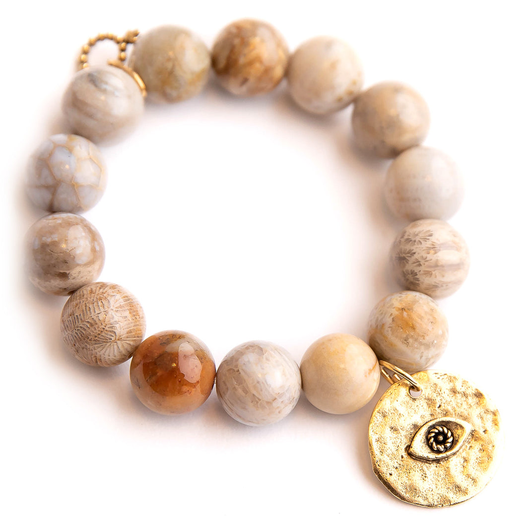 Sand dune agate paired with a hammered bronze evil eye
