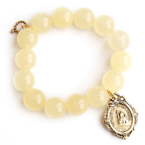 Lemonade jade paired with a bronze Notre Dame medal