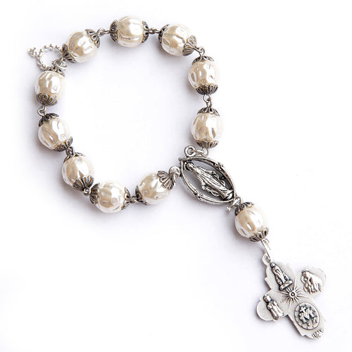 Vintage pearl decade rosary pocket chaplet paired with a silver Blessed Mother center and silver cross