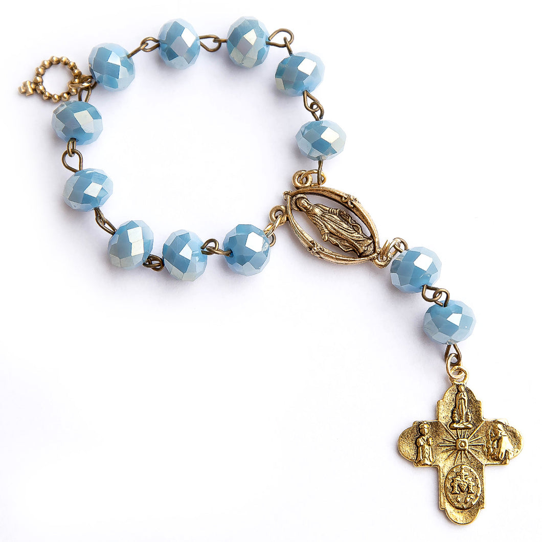 Ice blue agate decade rosary pocket chaplet paired with a brass Blessed Mother medal center and brass cross