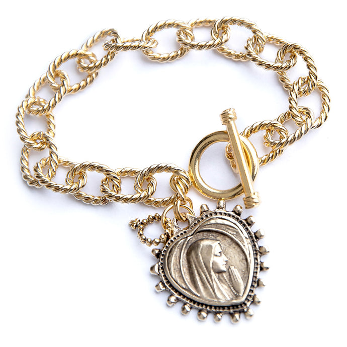 Gold plated twisted chain with a toggle clasp featuring an exclusively cast heart shaped Blessed Mother medal