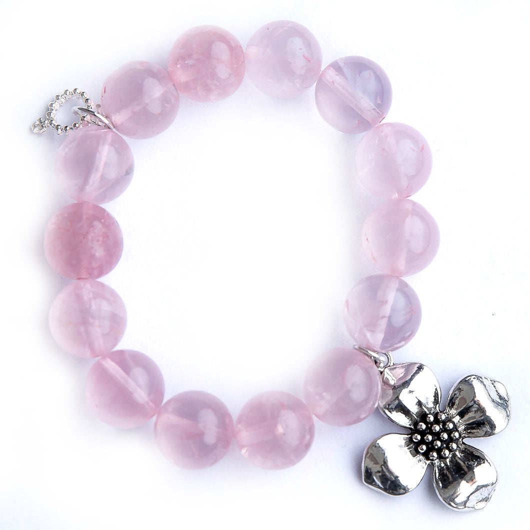Tea Rose quartz paired with a dogwood flower medal