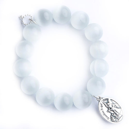 White calcite paired with an oval shaped guardian angel medal