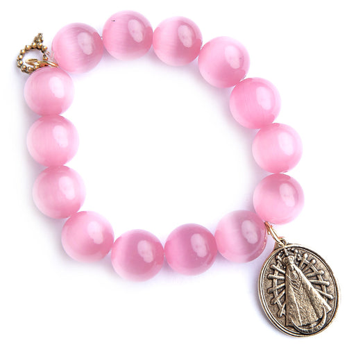 Blush calcite paired with an exclusively cast Our Lady of Lujan medal.