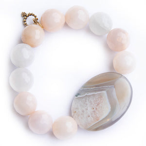 Pink aventurine paired with an oyster agate slice