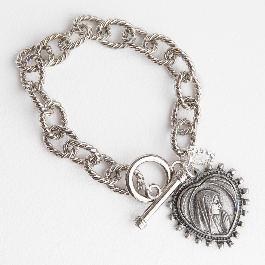 Silver plated twisted chain with a toggle clasp featuring an exclusively cast heart shaped Blessed Mother medal