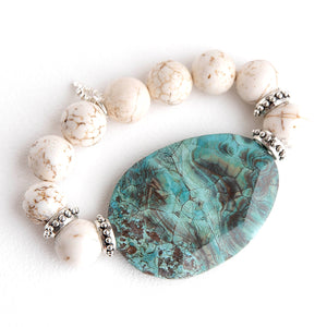 Creamy white howlite paired with a turquoise colored agate slice