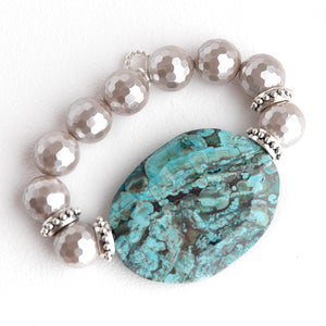 Mother of pearl paired with a turquoise colored statement agate slice