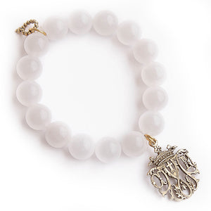 Translucent white jade with a brass Notre Dame Cathedral medal