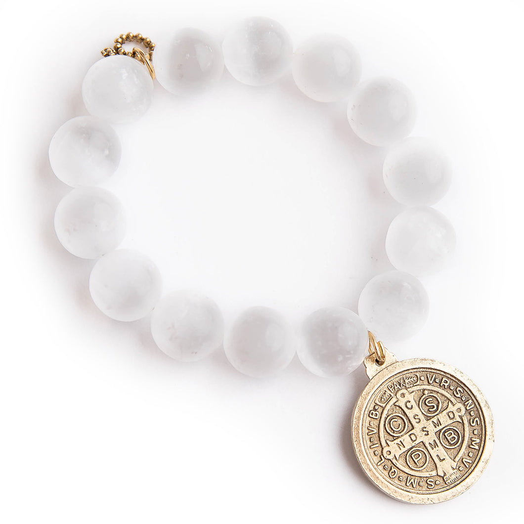 White calcite with bronze Saint Benedict medal