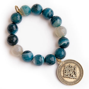 Faceted teal agate with brass Queen of Heaven medal