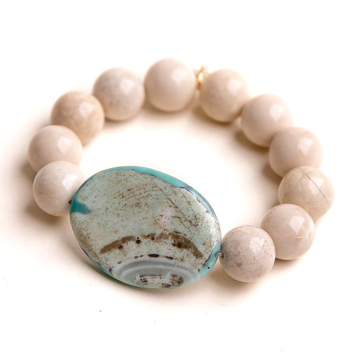 Cream coral paired with an oval aqua agate slice