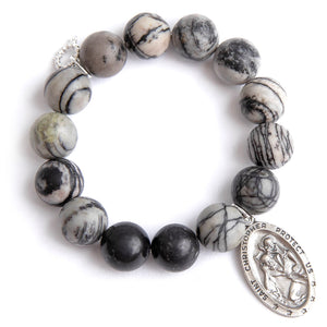 Black picasso jasper paired with a large oval silver Saint Christopher