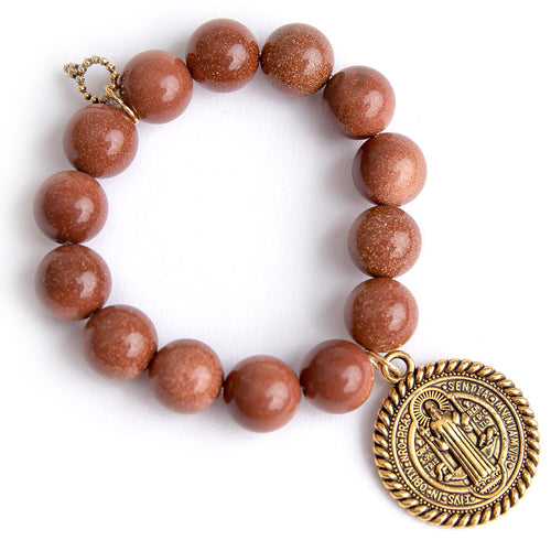 Amber goldstone paired with a large brass Saint Benedict
