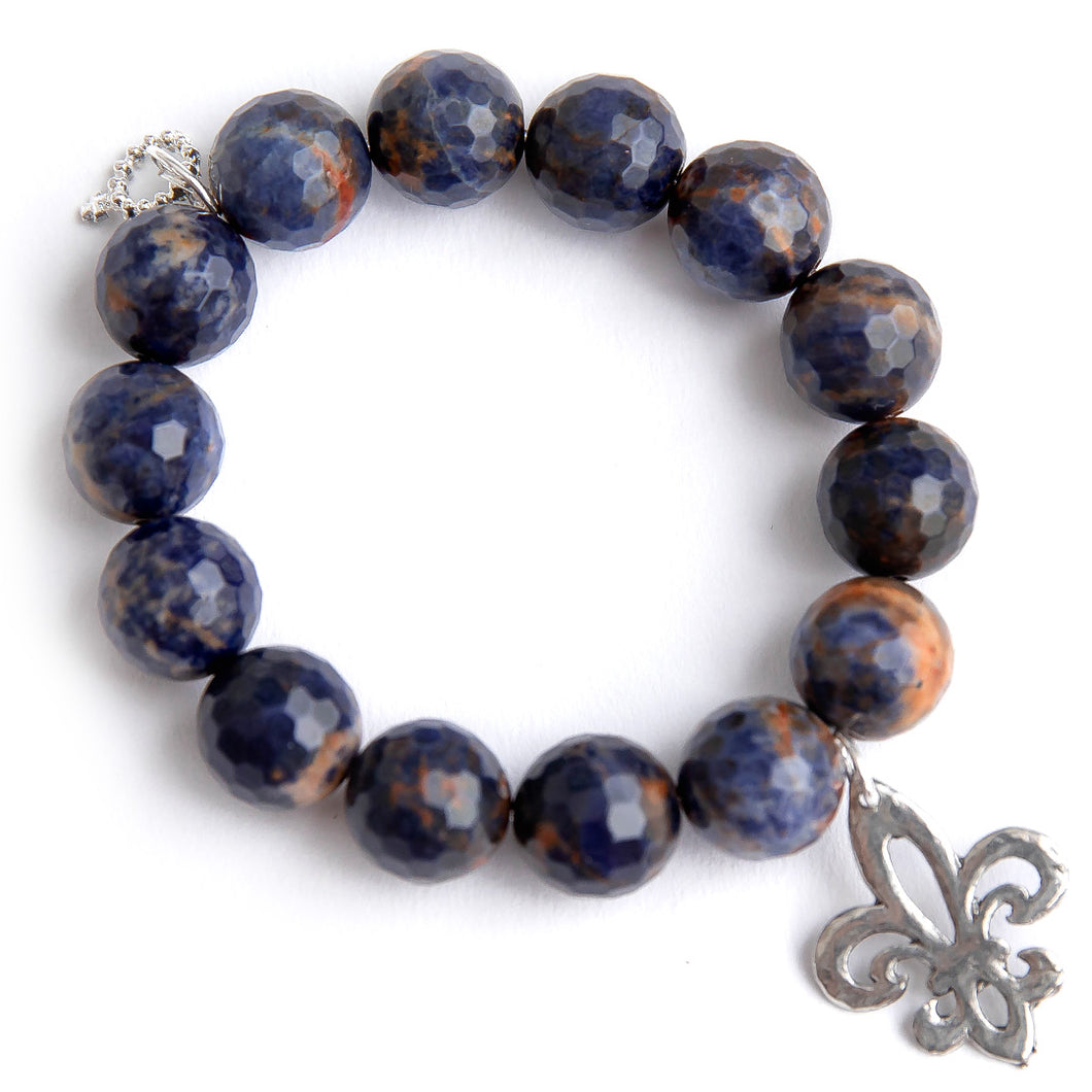 Sodalite paired with a silver open cut fleur di lis