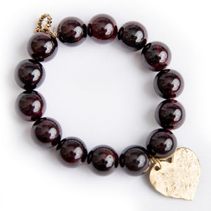 Garnet paired with a brass hammered heart