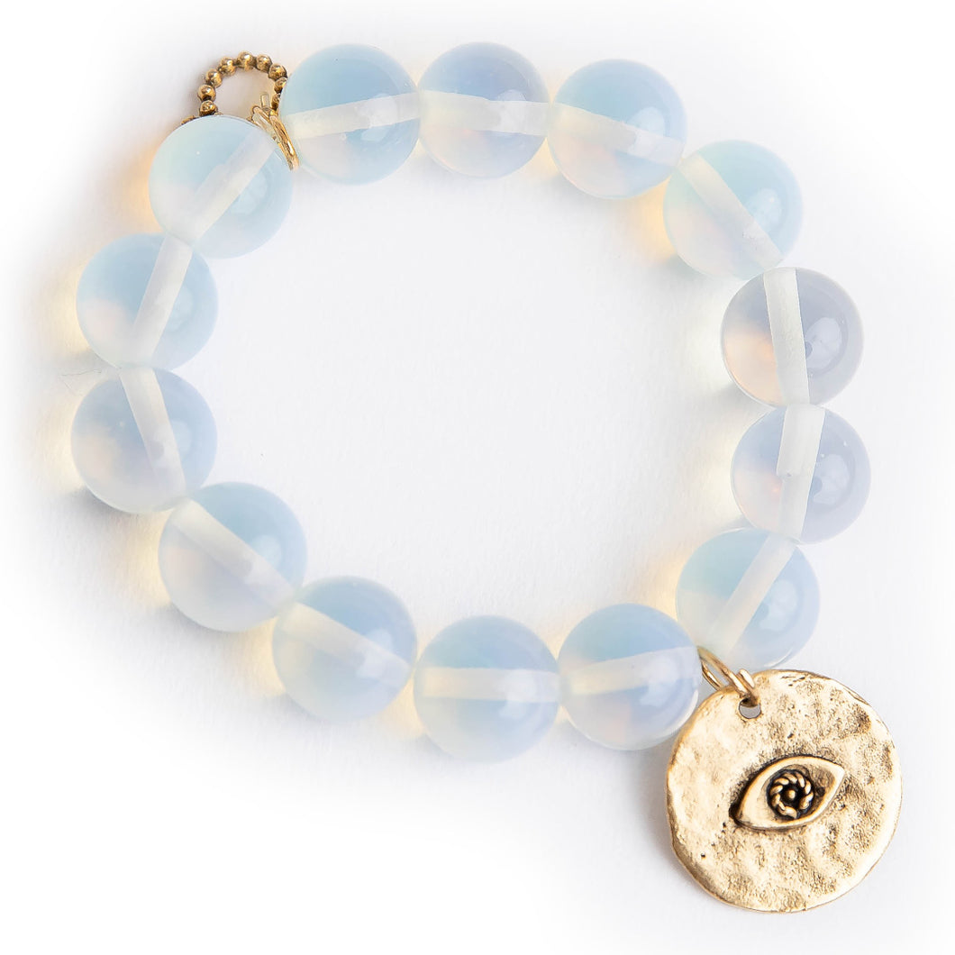 Opalite with a bronze hammered evil eye
