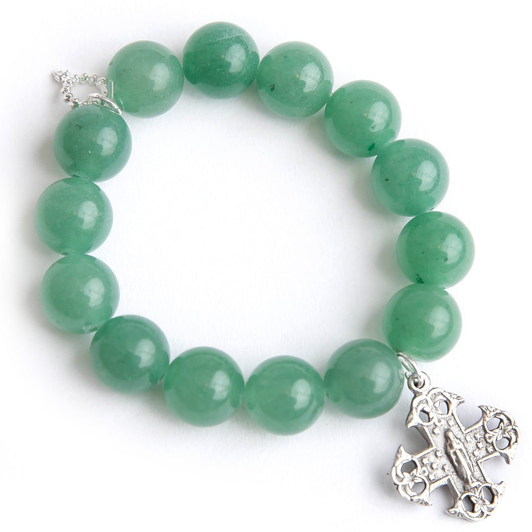 Green aventurine paired with a silver cross