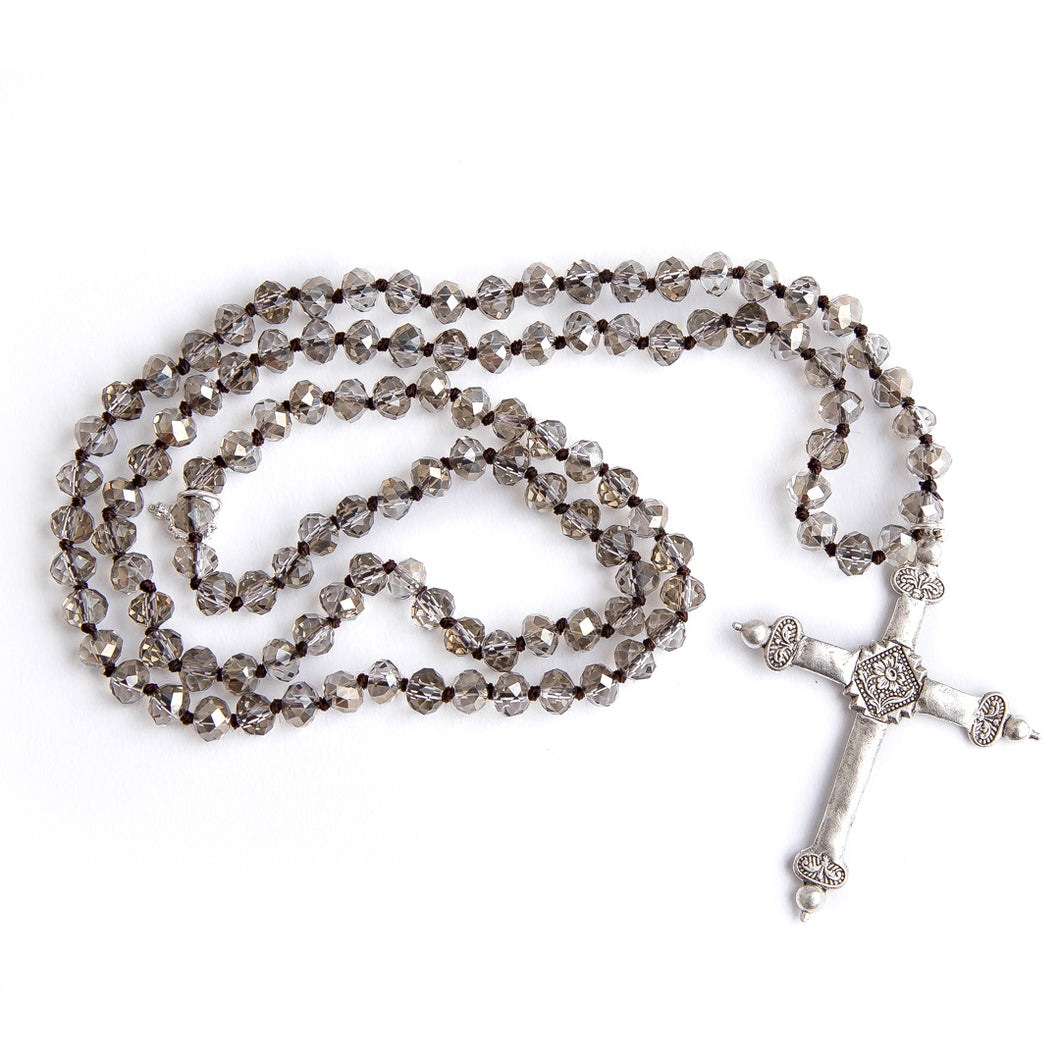 Hand tied smokey clear cut quartz gemstone necklace with silver cross