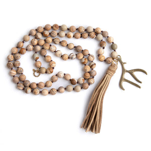 Hand tied matte picture jasper paired with a suede tassel and bronze antler medal