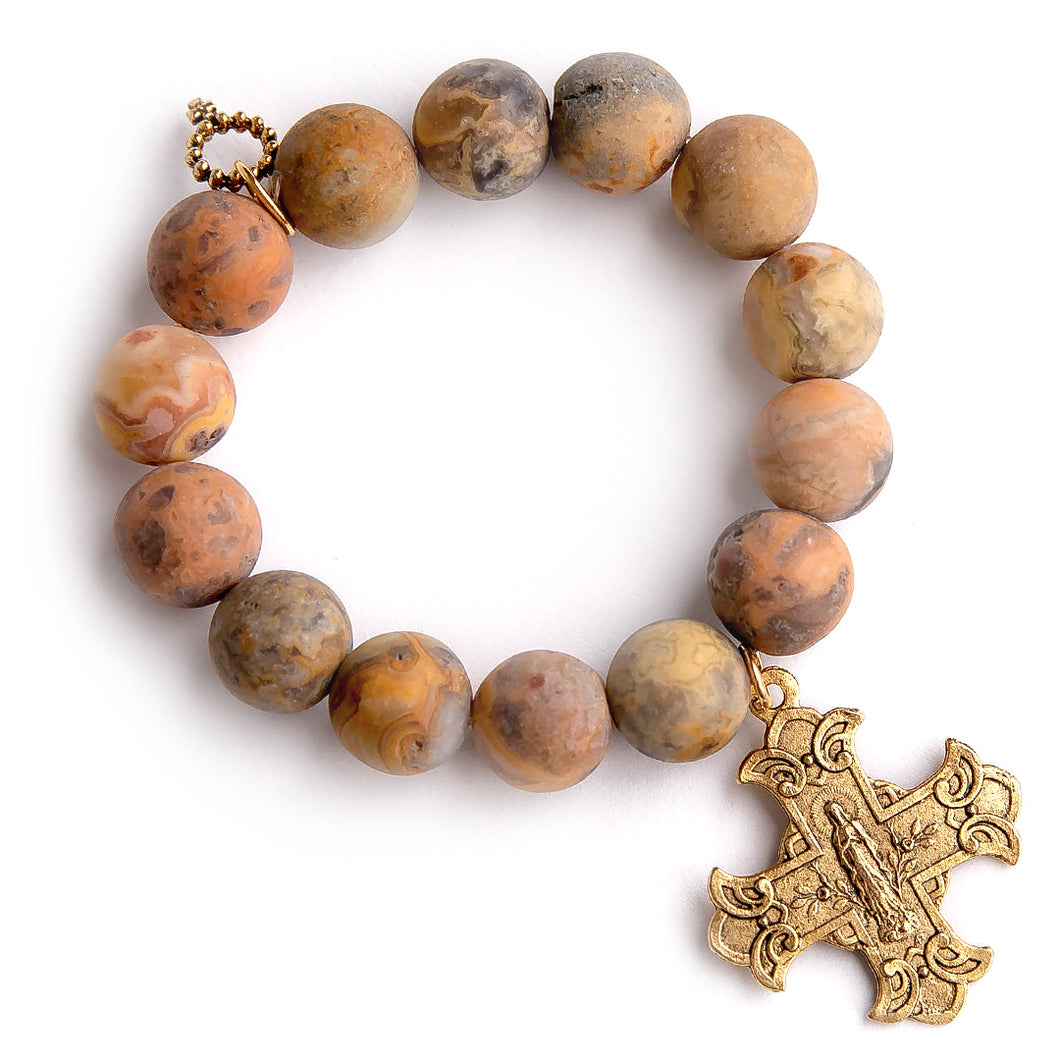 Matte desert sand agate paired with an exclusively cast bronze Sacred Heart cross