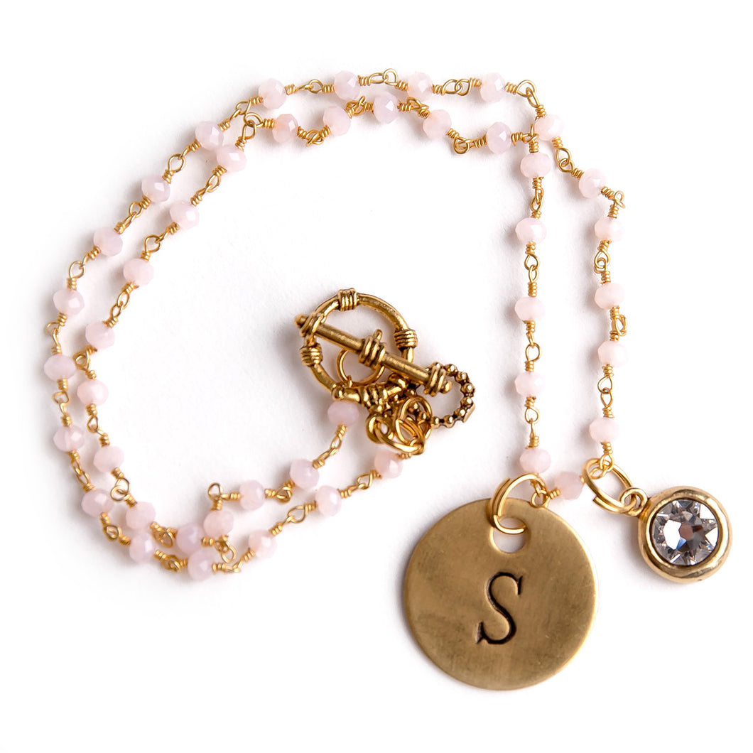 Rose Quartz rosary chain paired with an initial and a Swarovski crystal