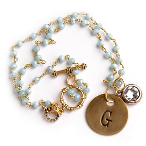 Aqua blue agate rosary chain paired with an initial and a Swarovski crystal