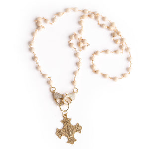 Cream coral convertible face mask necklace featuring an exclusively casted bronze Sacred Heart cross pendant