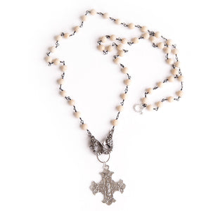 Cream coral face mask necklace featuring an exclusively casted silver Sacred Heart cross pendant