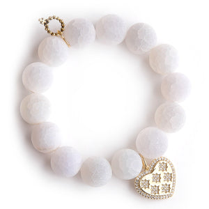 Matte white lace agate paired with a brass pave heart